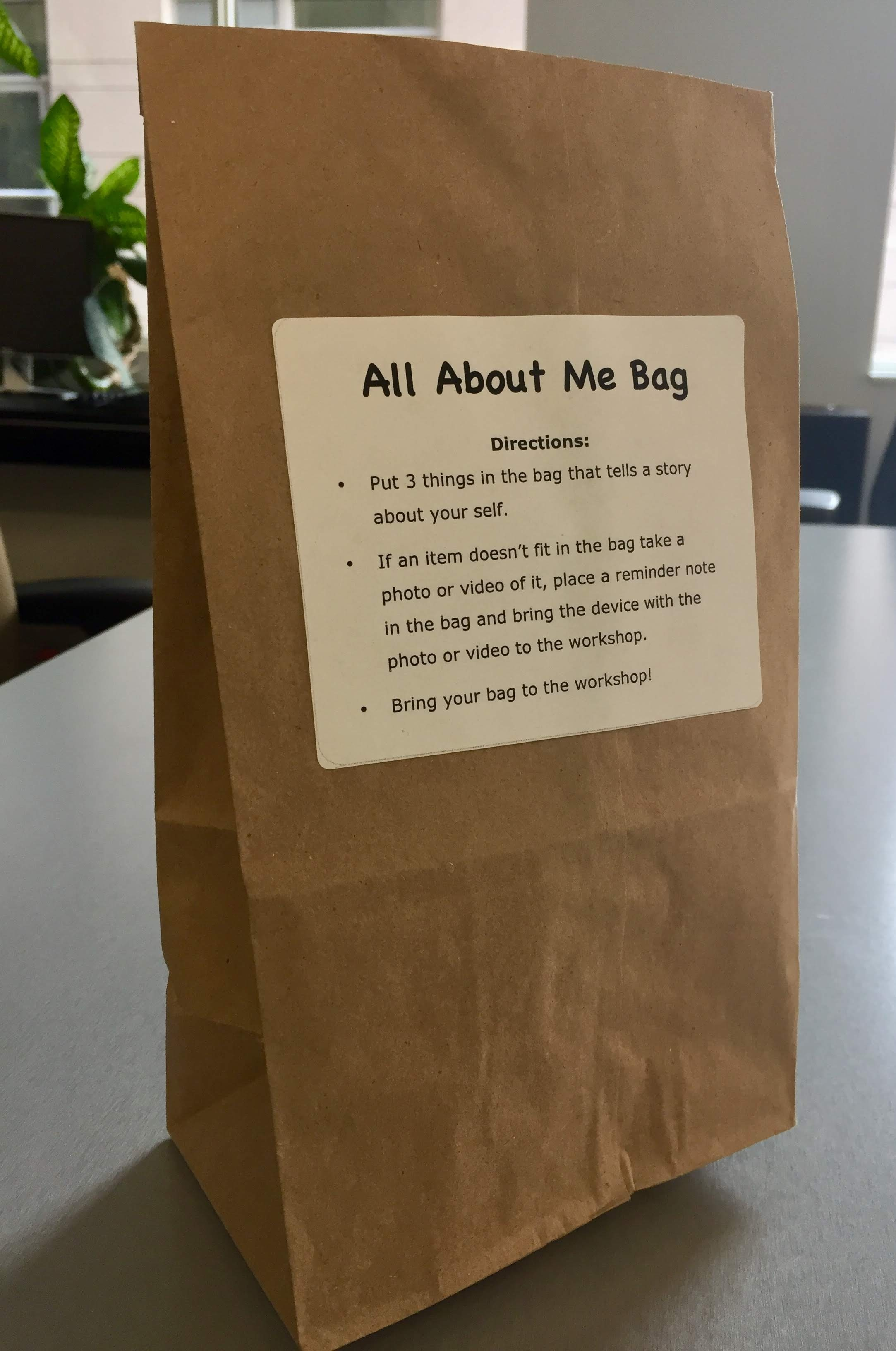 Paper bag with All About Me Bag 3-step instructions label stuck on the front